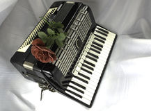 Accordion and rose. The historic Accordion with a red rose on top Royalty Free Stock Photos