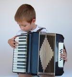 Accordion Time. Boy playing accordion Stock Photo