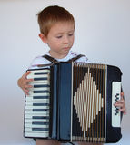 Accordion Time Too. Boy playing the accordion Royalty Free Stock Images