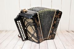Accordion with unrolled furs. Russian folk musical instrument royalty free stock photography