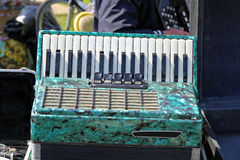 Accordion. Used Green Piano Accordion Musical Instrument at Flea Market royalty free stock photo