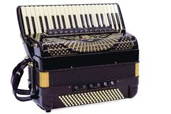 Accordion in white. Accordion in closeup key while waiting for the interpreter stock photography