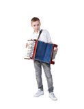 Accordion. Young boy playing on accordion, isolated on white, clipping path royalty free stock image