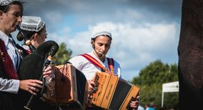 Accordionist and bagpiper in a traditional folk dance stock photos