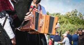 Accordionist and bagpiper in a traditional folk dance royalty free stock image