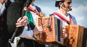 Accordionist and bagpiper in a traditional folk dance stock photography