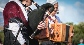 Accordionist and bagpiper in a traditional folk dance royalty free stock images