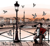 Accordionist playing on Pont des arts in Paris Royalty Free Stock Images