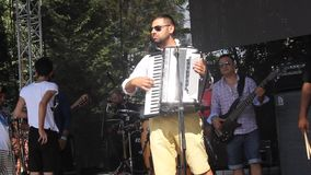 Accordionist playing Royalty Free Stock Images