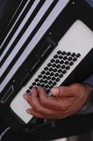 Accordions. The hand of a musician playing the accordions outdoors Royalty Free Stock Photography