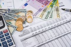 Account annual budget in office. dollar qand euro. Bills Royalty Free Stock Photos