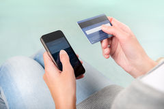 Account balance. Woman verifies account balance on smartphone with mobile banking application Royalty Free Stock Photos