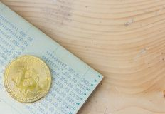Account book and bitcoin. Stock Image