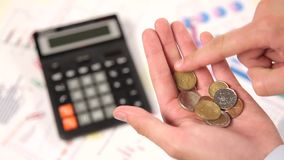 Account cents in hand. Hand pour down coins into hands of another person stock video footage