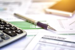 Account data and calculate. Review accounting data and calculate production income Stock Images