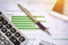 Account data and calculate. Review accounting data and calculate production income Stock Photos