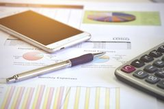 Account data and calculate. Review accounting data and calculate production income Royalty Free Stock Photos