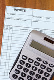 Account invoice with calculator Stock Images