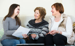 Account manager helping women with finances at home Stock Photography