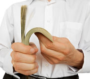 Account of money in hands. The businessman counts money in hands. isolated on white Stock Photo