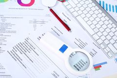 Account sheet, pen, keyboard, magnifying glass and mouse. stock images