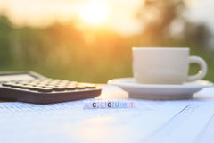 Account written in letter beads and a coffee cup on table Royalty Free Stock Images