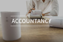 Accountancy text over accountant or financial adviser. Making calculations using adding machine royalty free stock photo