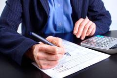 Accountant. Filling the forms out royalty free stock images
