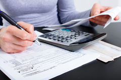 Accountant. Filling the forms out stock image