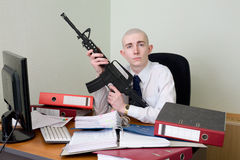 Accountant armed with a rifle Royalty Free Stock Photo