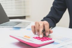 Accountant or banker making calculations. Savings,Concept finances and economy. Accountant or banker making calculations. Savings,Concept finances and investment Stock Photography