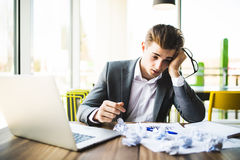 Accountant businessman working with documents in office having a stress. Accountant businessman working in office having a stress Royalty Free Stock Photo