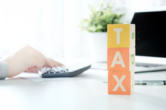 Accountant calculates tax. Working in the office with calculator Royalty Free Stock Photo