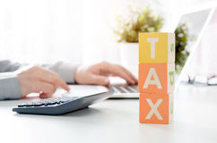 Accountant calculates tax. Working in the office with calculator Royalty Free Stock Photography