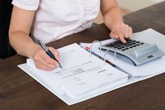 Accountant Calculating Bills Stock Photo