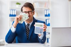 The accountant calculating dollars with calculator in office Royalty Free Stock Image