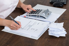 Accountant Calculating Receipt Stock Image