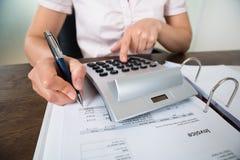 Accountant Calculating Receipt Stock Photos