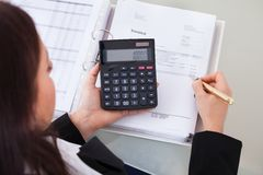 Accountant calculating tax at desk Royalty Free Stock Image