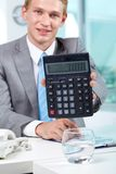 Accountant with calculator Royalty Free Stock Image
