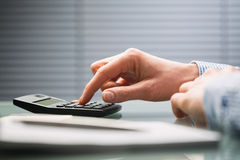 Accountant with Calculator - Finances Stock Photo