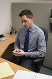 Accountant Check Cell Phone at Office Stock Photos