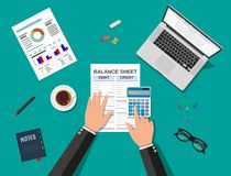 Accountant checks money balance. Accountant with report and a calculator checks money balance. Financial reports statement and documents. Accounting, bookkeeping Stock Photos