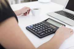 Accountant with coffee at her workplace Stock Images