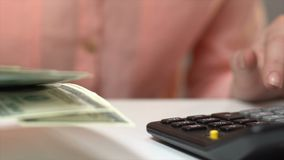Accountant counting dollar bills, planning budget, currency exchange, income. Stock footage stock video footage