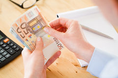Accountant Counting Euros Stock Image