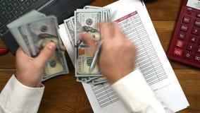 Accountant Counts Dollar Bills stock footage