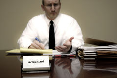 Accountant at Desk Stock Images