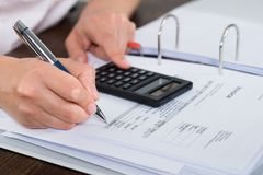 Accountant Doing Calculation Royalty Free Stock Photos