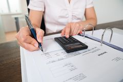 Accountant Doing Calculation Royalty Free Stock Photography